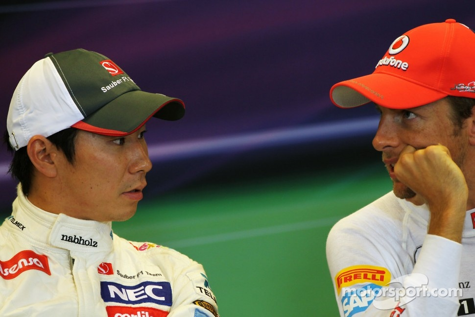 Pole sitter Jenson Button, McLaren, in the FIA Press Conference with Kamui Kobayashi, Sauber