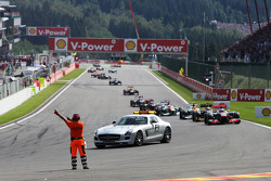 Jenson Button, McLaren leads behind the FIA Safety Car