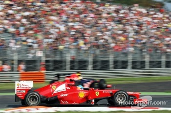 Fernando Alonso, Ferrari as Sebastian Vettel, Red Bull Racing runs wide at the chicane