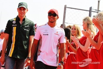 Vitaly Petrov, Caterham and Lewis Hamilton, McLaren on the drivers parade