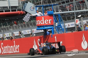 Race winner Lewis Hamilton, McLaren takes the chequered flag at the end of the race