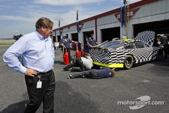 Robin Pemberton, vice president for competition of NASCAR, looks on in the garage area