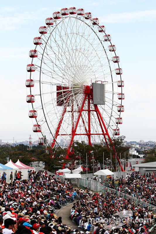 Fans in the grandstand and the ferris wheel