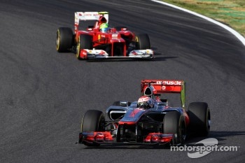 Jenson Button, McLaren leads Felipe Massa, Ferrari