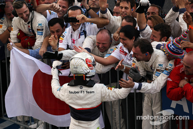 Kamui Kobayashi, Sauber celebrates his third position in parc ferme with the team