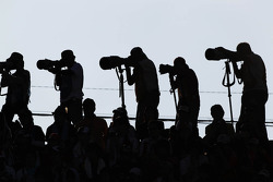 Photographers in the fans' grandstand