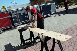 Marussia F1 Team mechanic works on the Marussia F1 Team MR01 plank