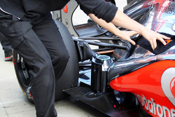 Jenson Button, McLaren exhaust and rear suspension detail