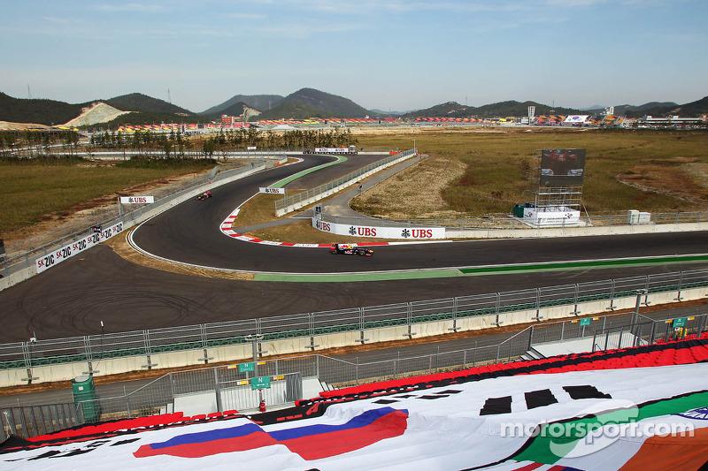 Mark Webber, Red Bull Racing leads team mate Sebastian Vettel, Red Bull Racing