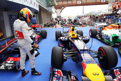 Lewis Hamilton, McLaren takes a look at the Red Bull Racing of pole sitter Mark Webber, Red Bull Racing in parc ferme