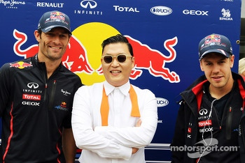 Psy, Rapper famous for Gangnam Style with Mark Webber, Red Bull Racing, and Sebastian Vettel, Red Bull Racing
