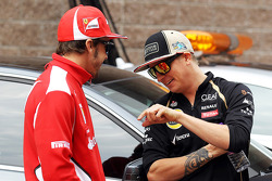 Fernando Alonso, Ferrari with Kimi Raikkonen, Lotus F1 Team