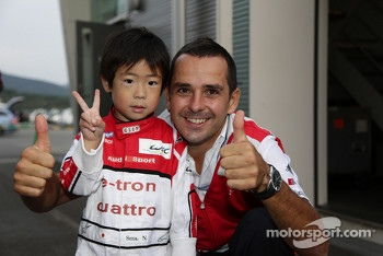 Benoit Trluyer with a young fan