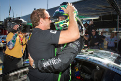 GT pole winner Guy Cosmo celebrates with teammate Ed Brown