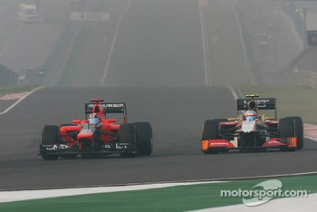 Timo Glock, Marussia F1 Team and Narain Karthikeyan, HRT Formula One Team HRT battle for position