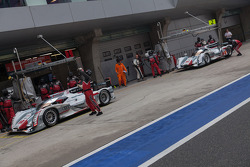 Both Audi e-tron quattro in pit lane