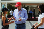 Niki Lauda, signs autographs for the fans