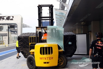 McLaren fork lift truck shatters the glass awning above the pit garage
