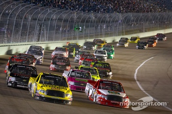Kyle Busch, Kyle Busch Motorsports Toyota and Parker Kligerman, Red Horse Racing Toyota battle for the lead