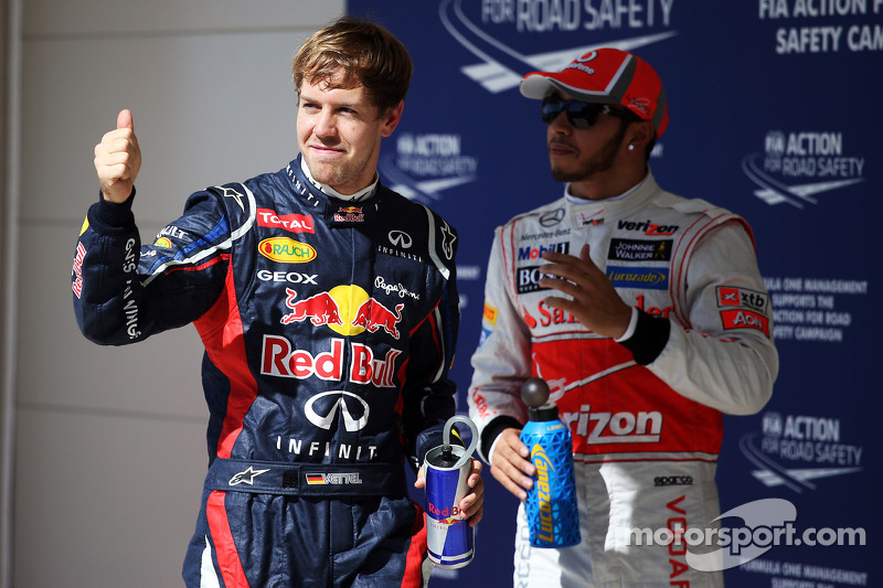 Sebastian Vettel, Red Bull Racing celebrates his pole position in parc ferme with Lewis Hamilton, McLaren