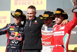 The podium: Sebastian Vettel, Red Bull Racing, second; Martin Whitmarsh, McLaren Chief Executive Officer; Lewis Hamilton, McLaren, race winner; Fernando Alonso, Ferrari, third
