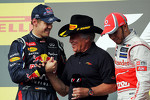 The podium: Sebastian Vettel, Red Bull Racing, second; Mario Andretti, Lewis Hamilton, McLaren, race winner