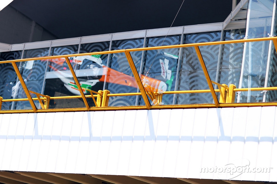 Sahara Force India F1 VJM05 reflected above the pits