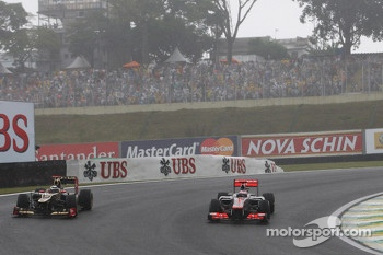 Kimi Raikkonen, Lotus F1 and Jenson Button, McLaren