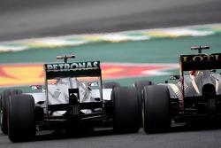 Michael Schumacher, Mercedes GP and Kimi Raikkonen, Lotus F1 Team