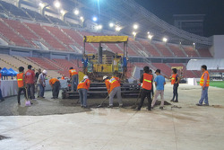 Crews build the track