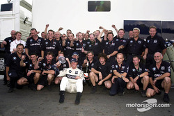 Ralf Schumacher celebrates third place with the Williams team