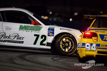 #72 Park Place Motorsports Porsche GT3: Chuck Cole, Grant Phipps, Mike Vess, Alex Whitman spins in front of #94 Turner Motorsport BMW M3: Bill Auberlen, Paul Dalla Lana, Boris Said