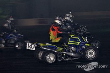 Quad bike racing in the live action arena