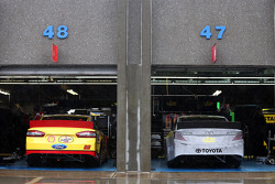 Cars wait in the garage area