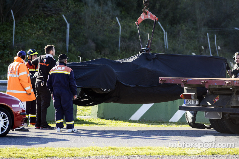 The McLaren MP4-28 of Jenson Button, McLaren is recovered back to the pits on the back of a truck