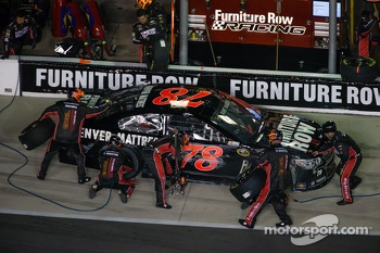 Kurt Busch, Furniture Row Racing Chevrolet in the pit with damage