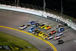 Greg Biffle, Roush Fenway Racing Ford and Martin Truex Jr., Michael Waltrip Racing Toyota lead the field