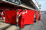 Ferrari put up red screens in the pits