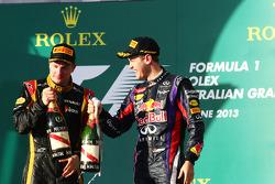 (L to R): Race winner Kimi Raikkonen, Lotus F1 Team celebrates on the podium with Sebastian Vettel, Red Bull Racing