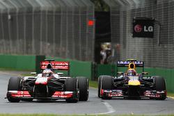 Jenson Button, McLaren MP4-28 leads Mark Webber, Red Bull Racing RB9