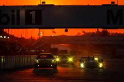 #11 JDX Racing Porsche 911 GT3 Cup: Mike Hedlund, Jan Heylen, Jon Fogarty, #52 PR1 Mathiasen Motorsports Molecule Oreca FLM09 Oreca: David Cheng, Mike Guasch, David Ostella