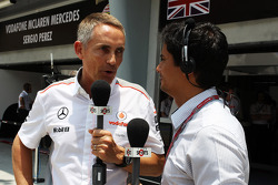 Martin Whitmarsh, McLaren Chief Executive Officer with Alex Yoong, Star Sports TV Presenter