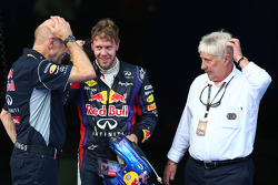 Race winner Sebastian Vettel, Red Bull Racing with Adrian Newey, Red Bull Racing Chief Technical Officer and Charlie Whiting, FIA Delegate