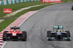 Max Chilton, Marussia F1 Team MR02 and Nico Rosberg, Mercedes AMG F1 W04