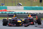 Sebastian Vettel, Red Bull Racing RB9 leads team mate Mark Webber, Red Bull Racing RB9