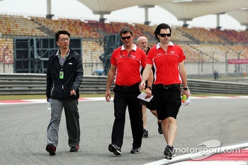 Graeme Lowdon, Marussia F1 Team Chief Executive Officer and Marc Hynes, Marussia F1 Team Driver Coach walk the circuit