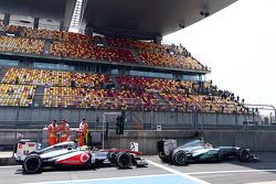 Lewis Hamilton, Mercedes AMG F1 W04 and Sergio Perez, McLaren MP4-28