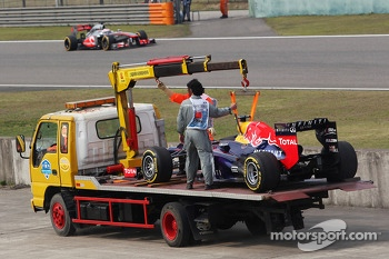 The Red Bull Racing RB9 of Mark Webber, Red Bull Racing is recovered back to the pits on the back of a truck after he stopped during qualifying. - www.xpbimages.com, EMail: requests@xpbimages.com - copy of publication required for printed pictures. Every