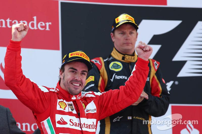 1st place Fernando Alonso, Ferrari F138 and Kimi Raikkonen, Lotus F1 Team