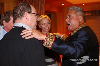 (L to R): HSH Prince Albert of Monaco, with his wife Princess Charlene of Monaco, and Dr. Vijay Mallya, Sahara Force India F1 Team Owner at the Signature F1 Monaco Party